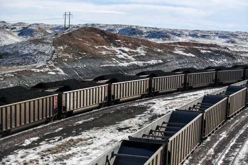 FILE - In this Jan. 9, 2014, file photo, rail cars are filled with coal and sprayed with a topper agent to suppress dust at Cloud Peak Energy's Antelope Mine north of Douglas, Wyo. Four states with climate change worries are asking a judge to stop the Trump administration from selling coal from public lands. Attorneys general from California, New Mexico, New York and Washington are due in a U.S. courtroom in Montana on Thursday, Dec. 13, 2018, to argue the sales put the climate at risk and shortchange taxpayers. Federal officials say the Trump administration's decision to lift a moratorium on coal sales from public lands could hasten the release of more than 5 billion tons of greenhouse gasses. (Ryan Dorgan/The Casper Star-Tribune via AP, File)