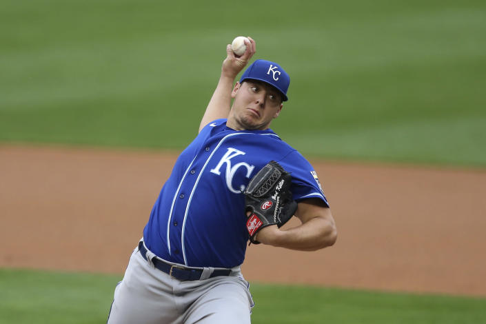 Kansas City Royals' pitcher Brad Keller throws against the Minnesota Twins during the first inning of a baseball game, Sunday, May 2, 2021, in Minneapolis. (AP Photo/Stacy Bengs)