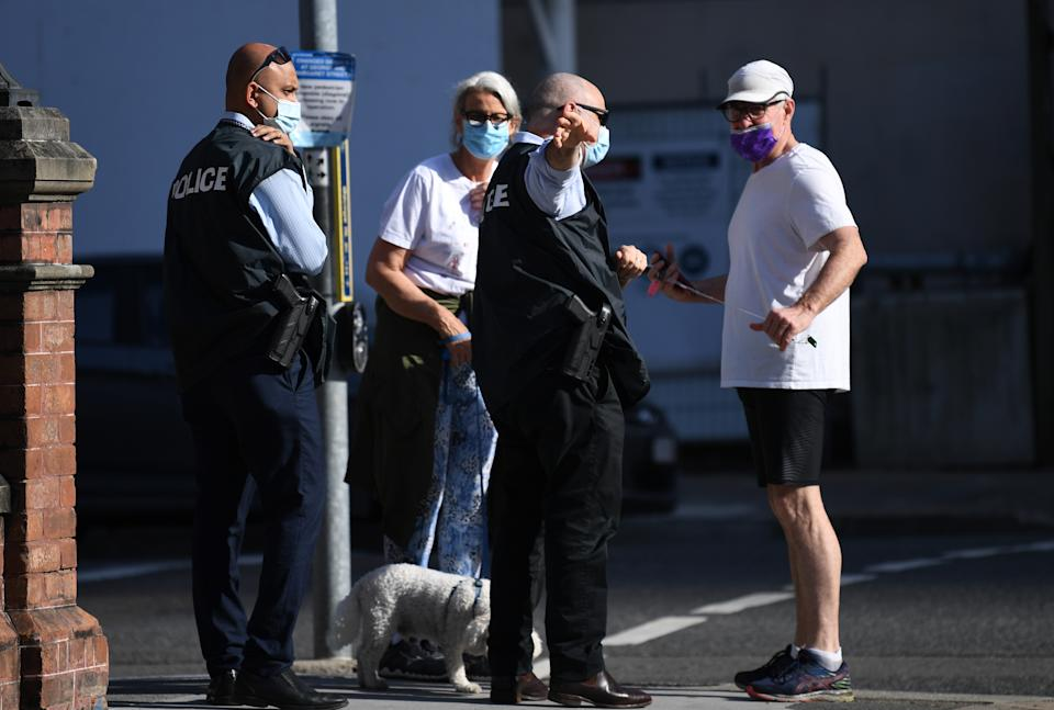Police check members of the public for compliance with lockdown orders in central Brisbane on Monday. Source: AAP