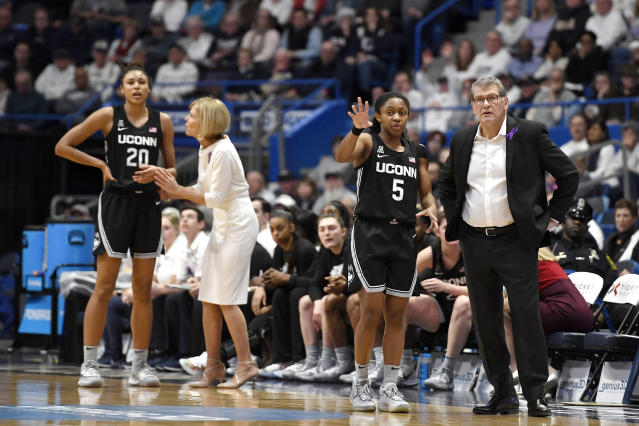 Connecticut head coach Geno Auriemma, right, talks with Connecticut's Crystal Dangerfield (5) as associate head coach Chris Dailey talks with Connecticut's Olivia Nelson-Ododa (20) in the first half of an NCAA college basketball game against Tennessee, Thursday, Jan. 23, 2020, in Hartford, Conn. (AP Photo/Jessica Hill)