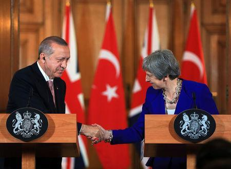 Turkish President Tayyip Erdogan shakes hands with Britain's Prime Minister Theresa May during a news conference after their meeting at Downing Street in London, Britain May 15, 2018. Cem Oksuz/Presidential Palace/Handout via REUTERS