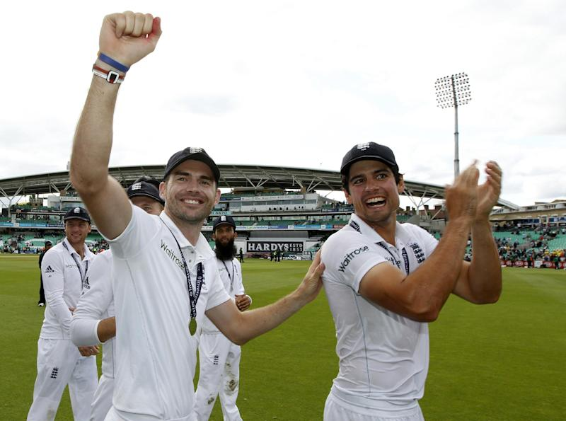England's James Anderson (L) and Alastair Cook celebrate their win in the Test and series against India at The Oval in London on August 17, 2014
