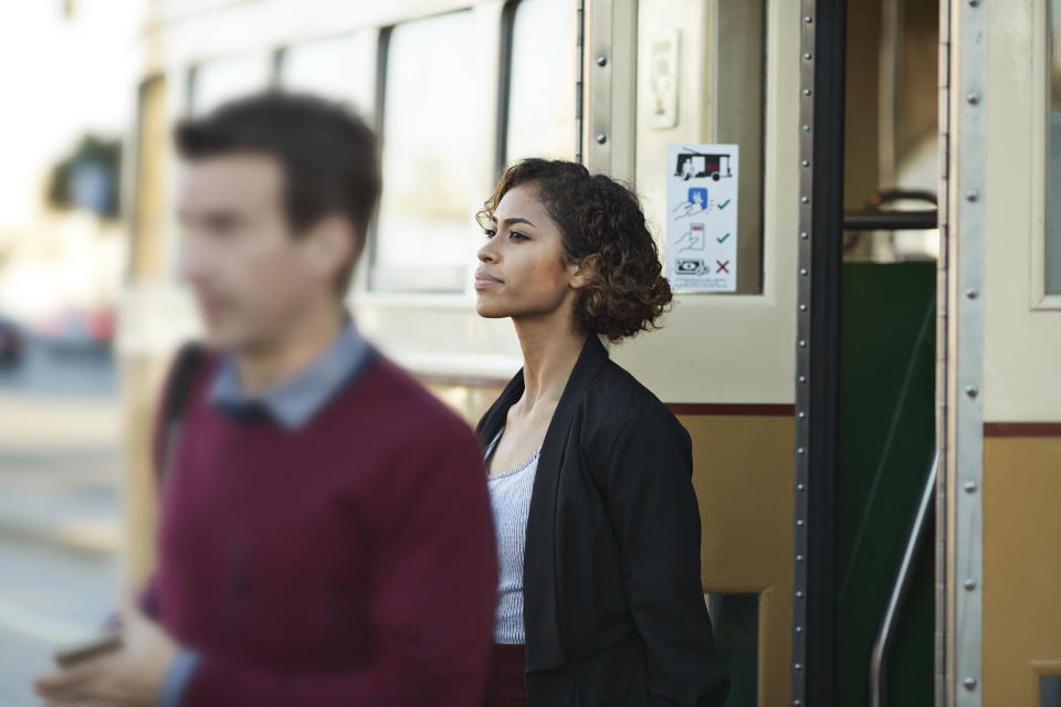 Woman and man getting of tram