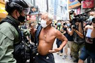 A man argues with a police officer during China's National Day in Hong Kong