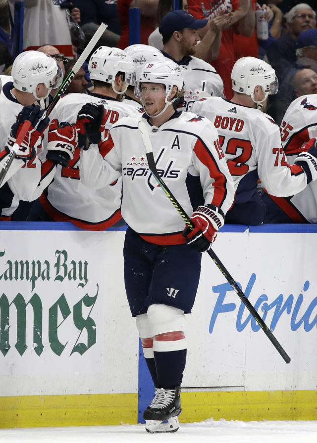 Washington Capitals center Nicklas Backstrom (19) celebrates with the bench after his goal against the Tampa Bay Lightning during the second period of an NHL hockey game Saturday, March 30, 2019, in Tampa, Fla. (AP Photo/Chris O'Meara)