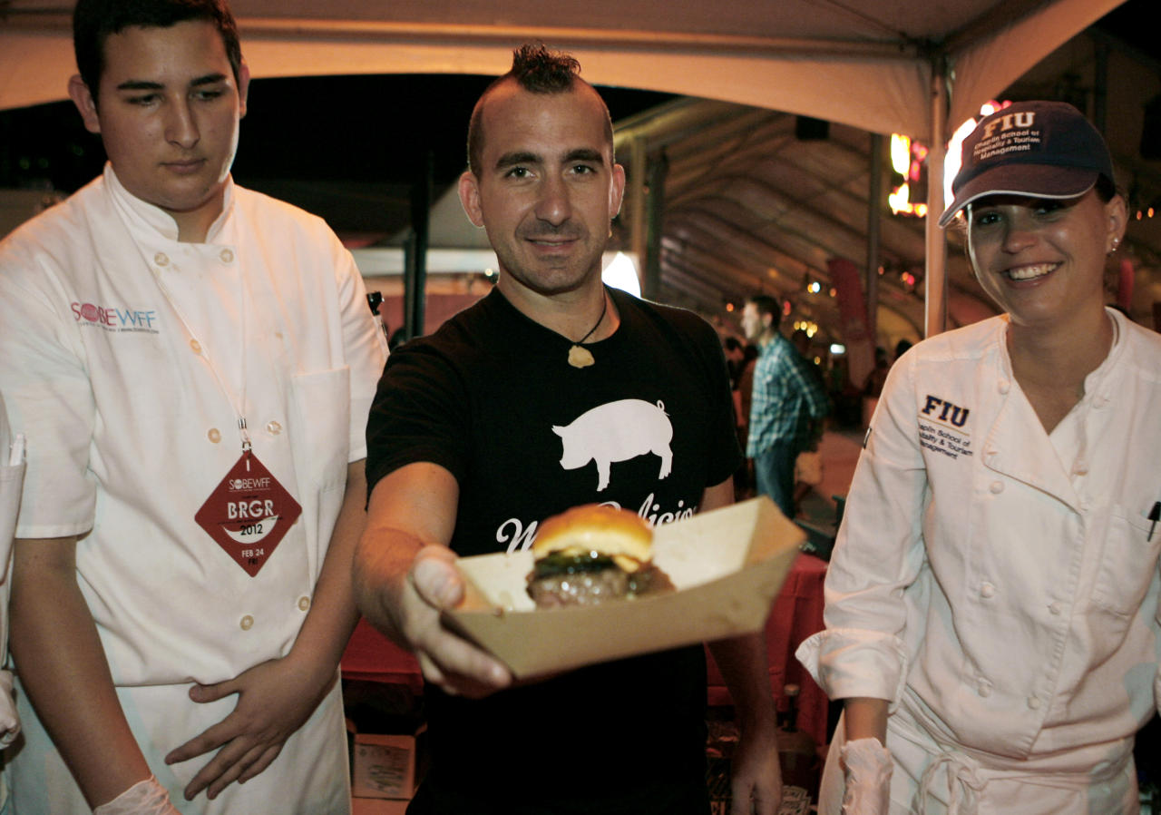 Chef Marc Forgione shows off his The Hangover 2 Burger while competing in the Burger Bash at the Food Network South Beach Wine & Food Festival in Miami Beach, Friday, Feb. 24, 2012.(AP photo/Jeffrey M. Boan)