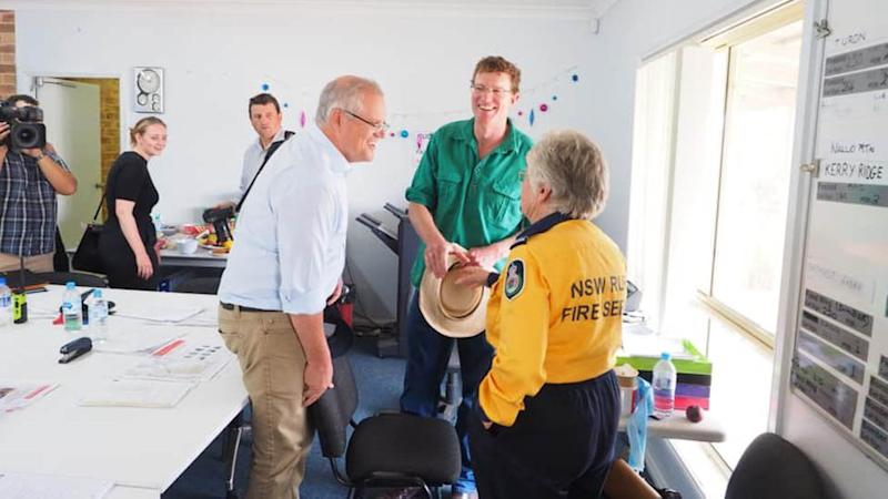 Scott Morrison (left) with MP Andrew Gee (middle) and NSW RFS volunteer Jacqui (right).