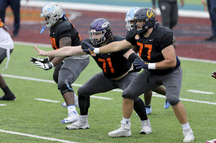 National Team offensive lineman Quinn Meinerz (71), center, of Wisconsin–Whitewater is making a name for himself at the 2021 Senior Bowl. (AP Photo/Rusty Costanza)