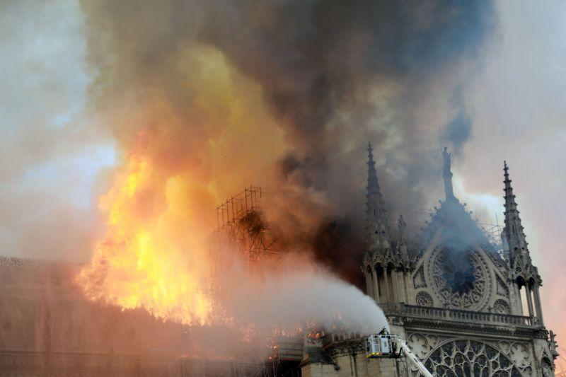 Firefighters tackle the blaze at the Notre Dame Cathedral. Source: Getty