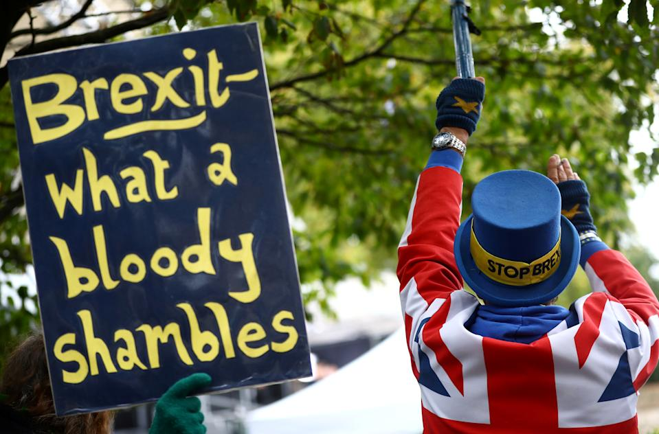 Anti-Brexit protesters demonstrate outside the Houses of Parliament in London, Britain, October 21, 2019. REUTERS/Hannah McKay
