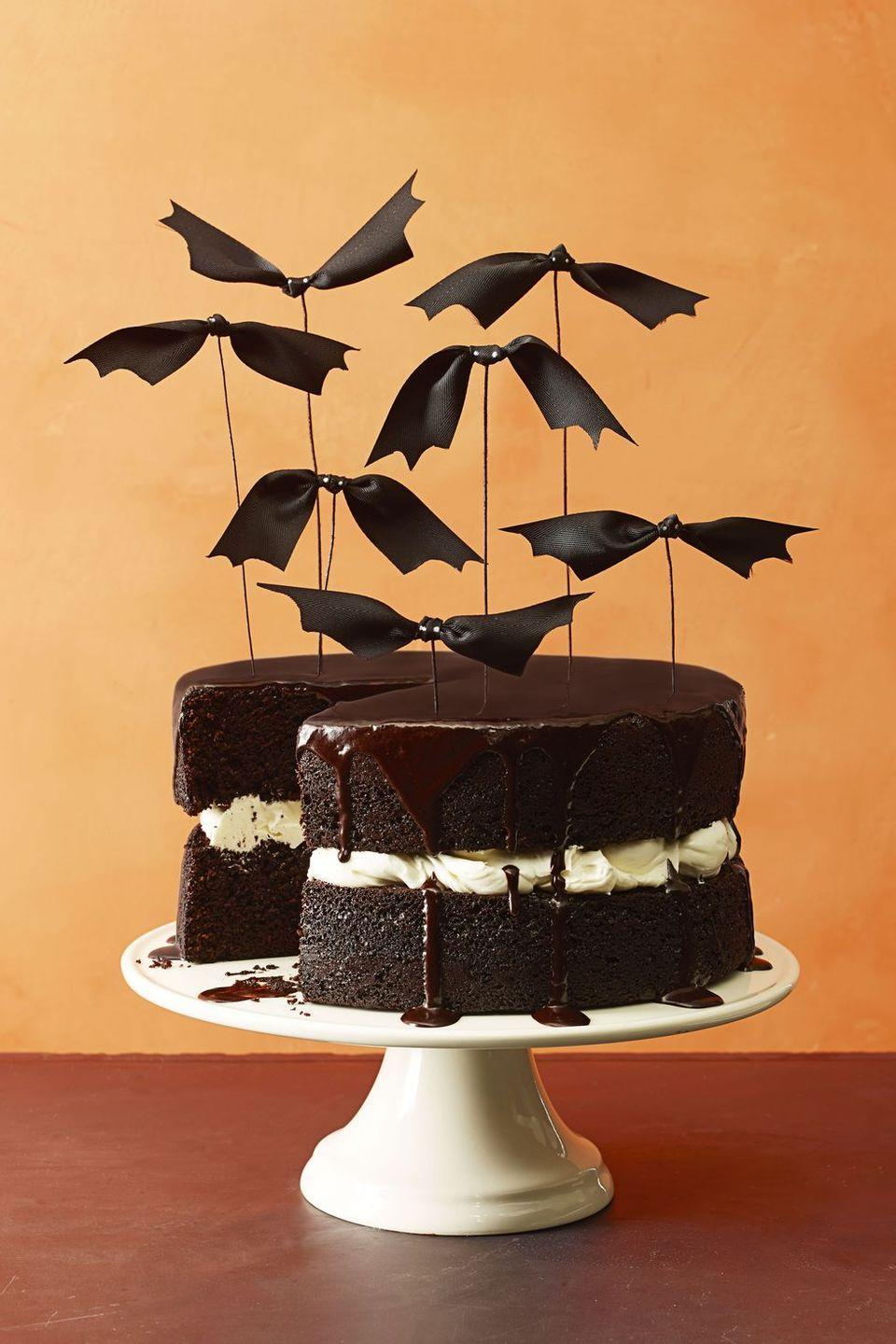 """<p>If you want your cake to steal the show this holiday, make this Brown Butter Frosting-soaked treat, and top it off with some flying bats.</p><p><em><strong>Get the recipe at <a href=""""https://www.goodhousekeeping.com/food-recipes/a16014/chocolate-pumpkin-cake-recipe-ghk1014/"""" rel=""""nofollow noopener"""" target=""""_blank"""" data-ylk=""""slk:Good Housekeeping"""" class=""""link rapid-noclick-resp"""">Good Housekeeping</a>.</strong></em></p>"""
