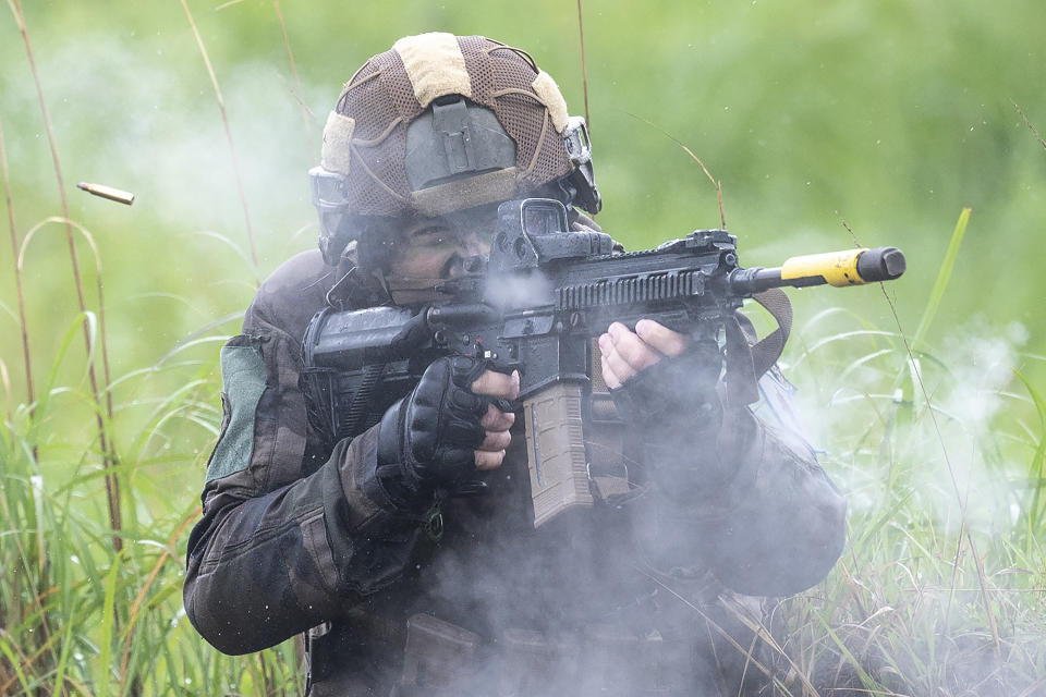 A French army soldier take part in a joint military drill between Japan Self-Defense Force, French army and U.S. Marines, at the Kirishima exercise area in Ebino, Miyazaki prefecture, southern Japan Saturday, May 15, 2021. (Charly Triballeau/Pool Photo via AP)