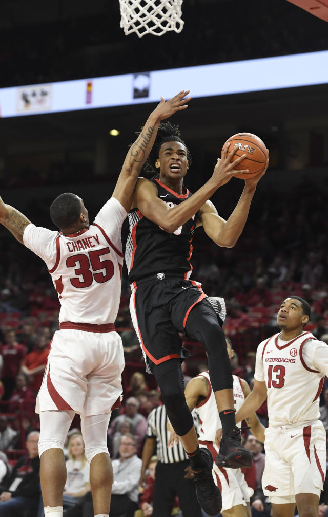 Georgia forward Nicolas Claxton (33) drives to the hoop past Arkansas defender Reggie Chaney (35) during the second half of an NCAA college basketball game, Tuesday, Jan.29, 2019 in Fayetteville, Ark. (AP Photo/Michael Woods)