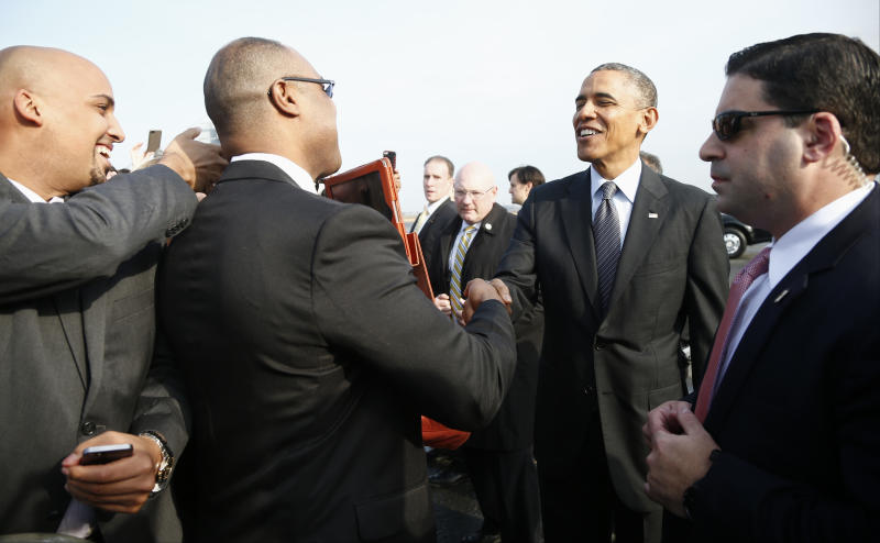 Obama to cite Mass. health care law's slow start