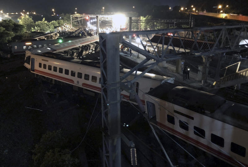 This photo released by Military News Agency shows a general view at the site of a train derailment in Lian in northern Taiwan on Sunday, Oct. 21 2018. The Puyuma express train was carrying more than 300 passengers toward Taitung, a city on Taiwan's southeast coast, when it went off the tracks on Sunday afternoon. (Taiwan Railways Administration via AP)