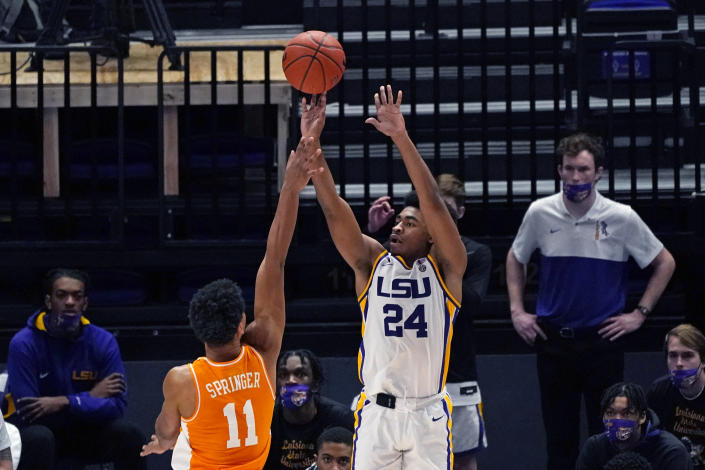 LSU guard Cameron Thomas (24) shoots over Tennessee guard Jaden Springer (11) in the second half of an NCAA college basketball game in Baton Rouge, La., Saturday, Feb. 13, 2021. (AP Photo/Gerald Herbert)