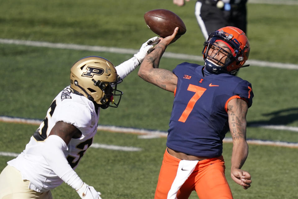 Purdue linebacker Jaylan Alexander, left, gets his hand on the throwing arm of Illinois quarterback Coran Taylor during the first half of an NCAA college football game Saturday, Oct. 31, 2020, in Champaign, Ill. (AP Photo/Charles Rex Arbogast)