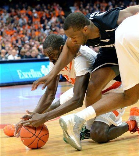 Syracuse's Baye Moussa Keita, left, battles Providence's Kadeem Batts for a loose ball during the first half in an NCAA college basketball game in Syracuse, N.Y., Wednesday, Feb. 20, 2013. (AP Photo/Kevin Rivoli)
