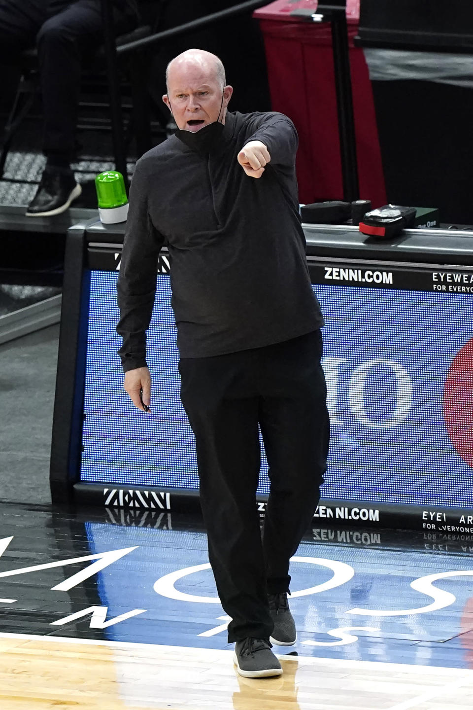 Orlando Magic coach Steve Clifford points as he talks to the team during the first half of an NBA basketball game against the Chicago Bulls in Chicago, Wednesday, April 14, 2021. (AP Photo/Nam Y. Huh)