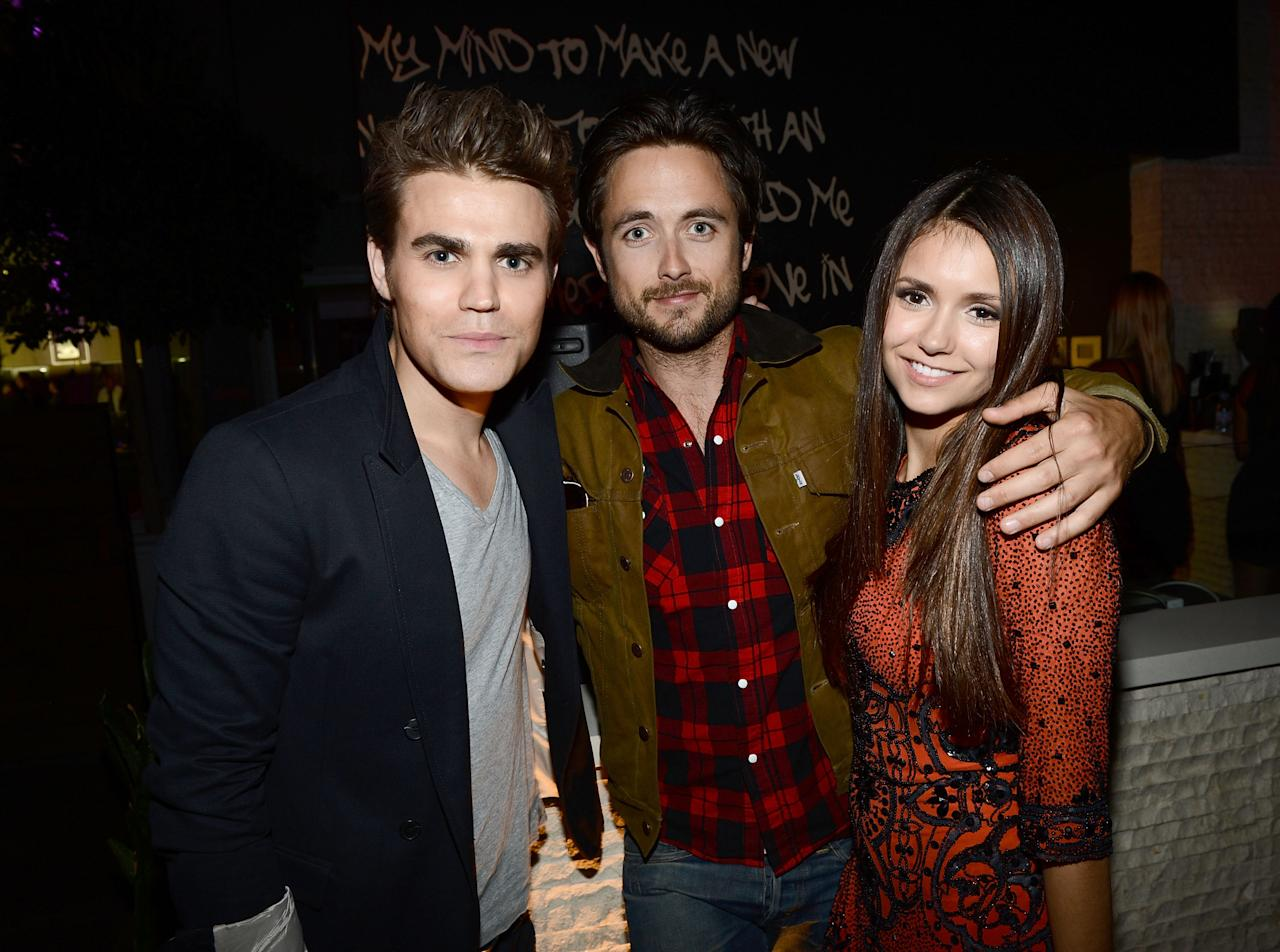 SAN DIEGO, CA - JULY 14:  (L-R) Actors Paul Wesley, Justin Chatwin and Nina Dobrev attend Entertainment Weekly's 6th Annual Comic-Con Celebration sponsored by Just Dance 4 held at the Hard Rock Hotel San Diego on July 14, 2012 in San Diego, California.  (Photo by Michael Buckner/Getty Images for Entertainment Weekly)