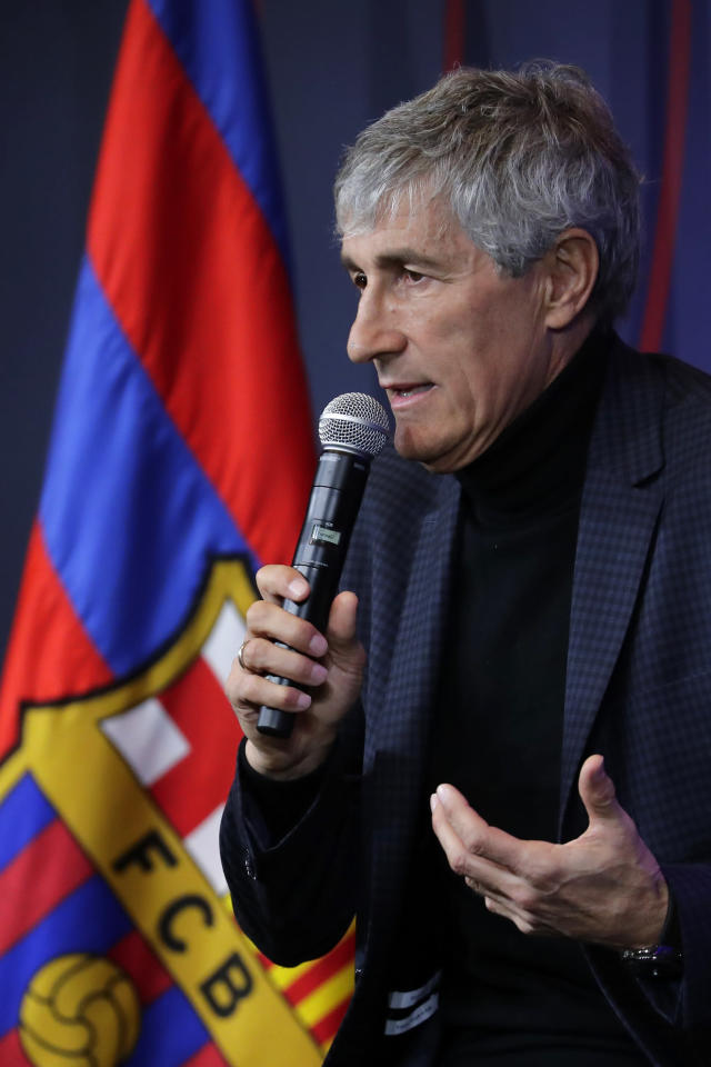 Quique Setien answers journalists during a news conference after being officially introduced as the new soccer coach of FC Barcelona at the Camp Nou stadium in Barcelona, Spain, Tuesday, Jan. 14, 2020. Barcelona made a rare coaching change midway through the season, replacing Ernesto Valverde with former Real Betis manager Quique Setien on Monday. (AP Photo/Emilio Morenatti)