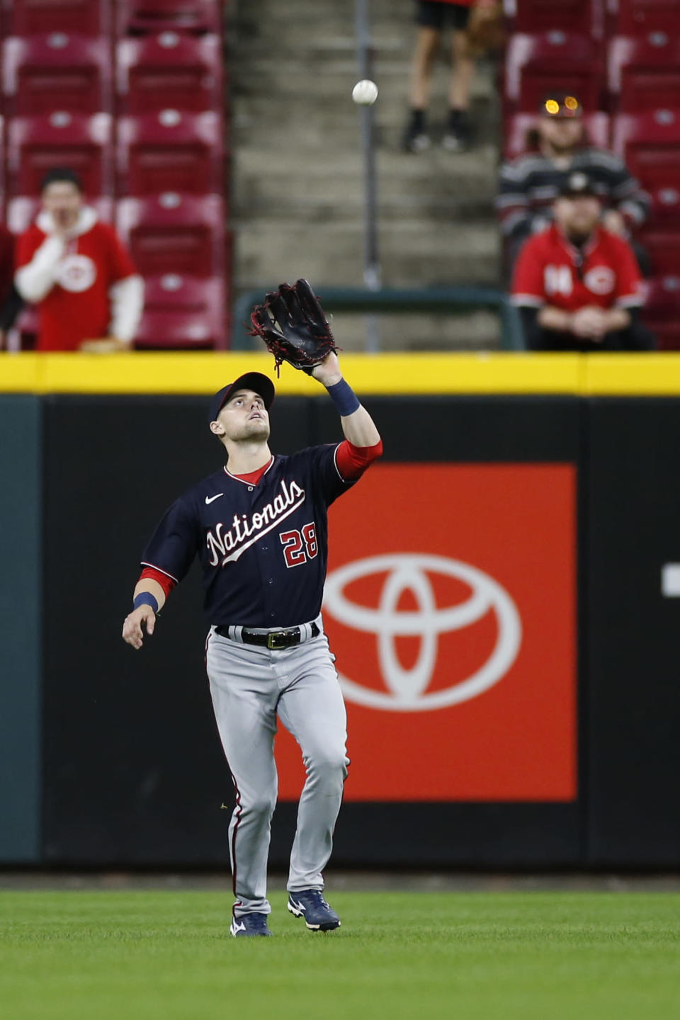 Washington Nationals' Lane Thomas catches a fly ball by the Cincinnati Reds during the ninth inning of a baseball game Thursday, Sept. 23, 2021, in Cincinnati. (AP Photo/Jay LaPrete)
