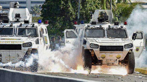 PHOTO: An explosion occurs under a military vehicle during clashes between forces loyal to Venezuelan President Nicolas Maduro and opposition demonstrators in Caracas on April 30, 2019. (Yuri Cortez/AFP/Getty Images)