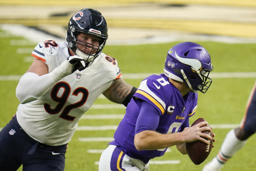 Chicago Bears defensive tackle Brent Urban (92) chases Minnesota Vikings quarterback Kirk Cousins (8) during the second half of an NFL football game, Sunday, Dec. 20, 2020, in Minneapolis. The Bears won 33-27. (AP Photo/Jim Mone)