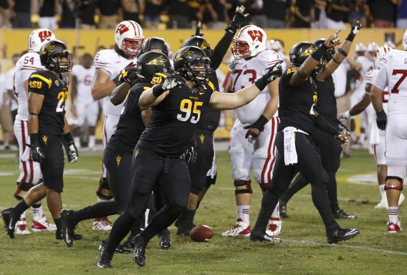 Arizona State's Gannon Conway (95) celebrates a win against Wisconsin as time expires in the second half of an NCAA college football game on Saturday, Sept. 14, 2013, in Phoenix. Arizona State defeated Wisconsin 32-30. (AP Photo/Ross D. Franklin)