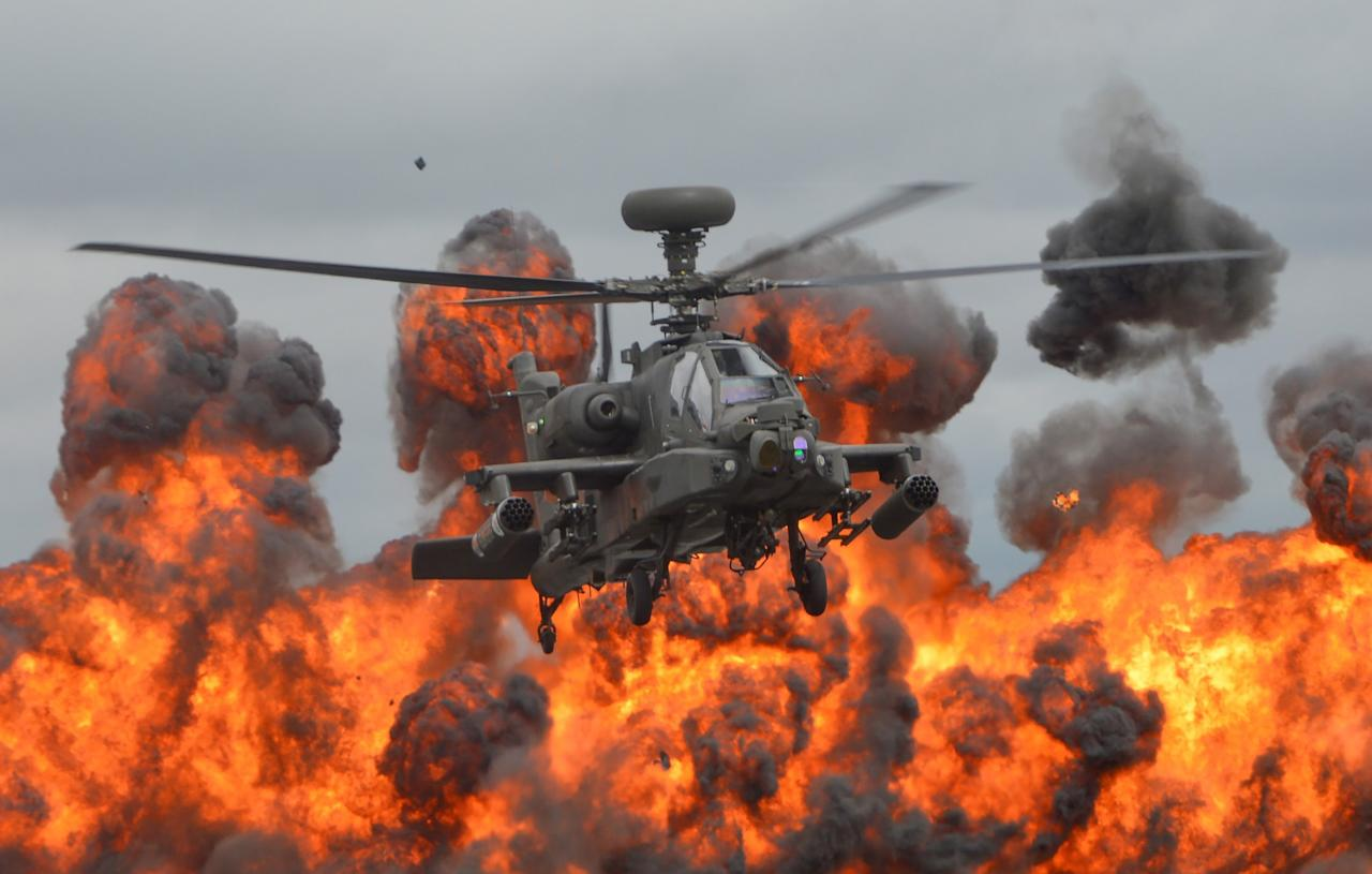 <p>Rising from the flames: An Apache helicopter puts on a spectacular display at the Royal International Air Tattoo. (Rex) </p>