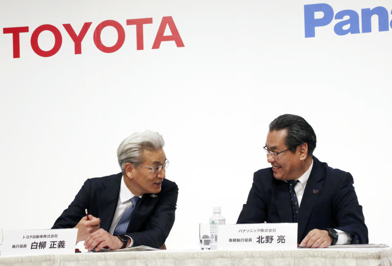 Operating Officer of Toyota Motor Corporation Masayoshi Shirayanagi, left, and Senior Managing Executive Officer of Panasonic Corporation Makoto Kitano talk during a press conference in Tokyo, Thursday, May 9, 2019. Japanese automaker Toyota and electronics maker Panasonic are forming a joint venture combining their housing businesses in Japan. (AP Photo/Koji Sasahara)