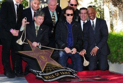 Music legend Paul McCartney watches as his star on the Hollywood Walk of Fame is unveiled