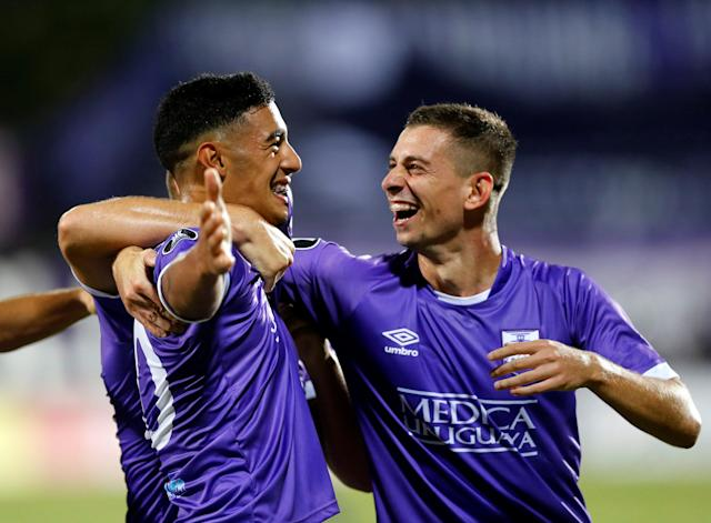 Soccer Football - Defensor Sporting v Monagas - Copa Libertadores - Luis Franzini Stadium, Montevideo, Uruguay - April 17, 2018. Defensor Sporting's Carlos Nahuel Benavidez celebrates with teammate Facundo Castro after scoring. REUTERS/Andres Stapff