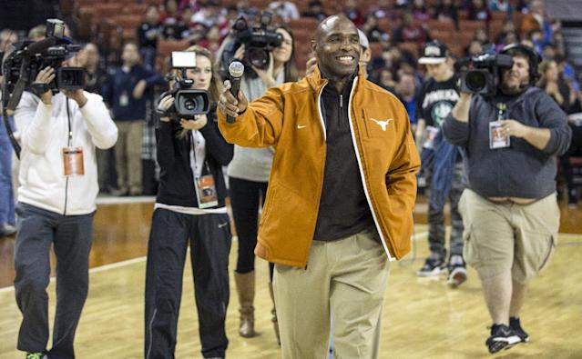 Texas new head football coach Charlie Strong speaks to fans during a timeout against Oklahoma in the first half of an NCAA college basketball game in Austin, Texas, Wednesday, Jan. 8, 2014. (AP Photo/Austin American- Statesman, Ricardo B. Brazziell)