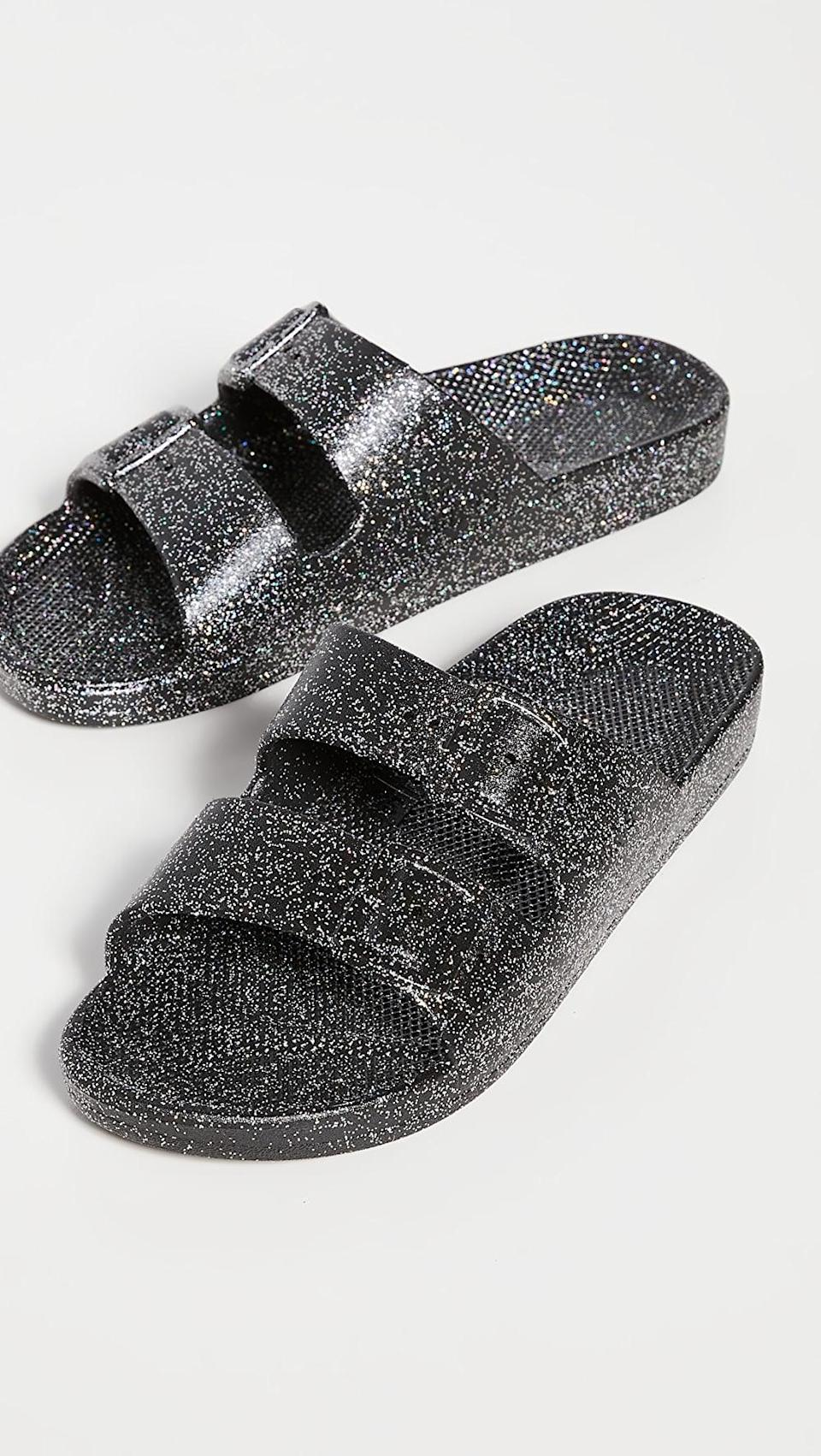 <p>These <span>Freedom Moses Glitter Two Band Slides</span> ($45) will be their go-to shoes when they're hanging around the house.</p>