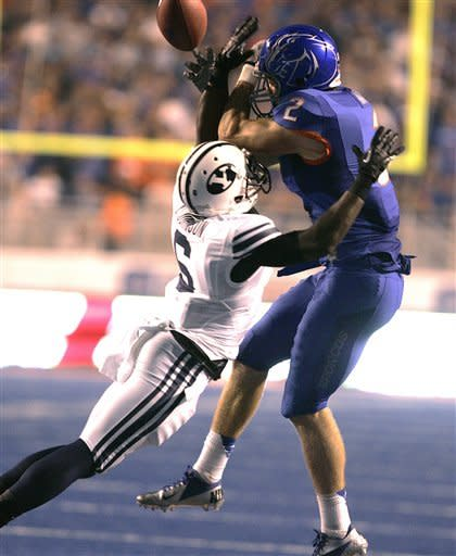 Brigham Young's Jordan Johnson (6) breaks up a play against Boise State's Cody Hoffman (2) during the first half of an NCAA college football game Thursday, Sept. 20, 2012 in Boise, Idaho. (AP Photo/Matt Cilley)
