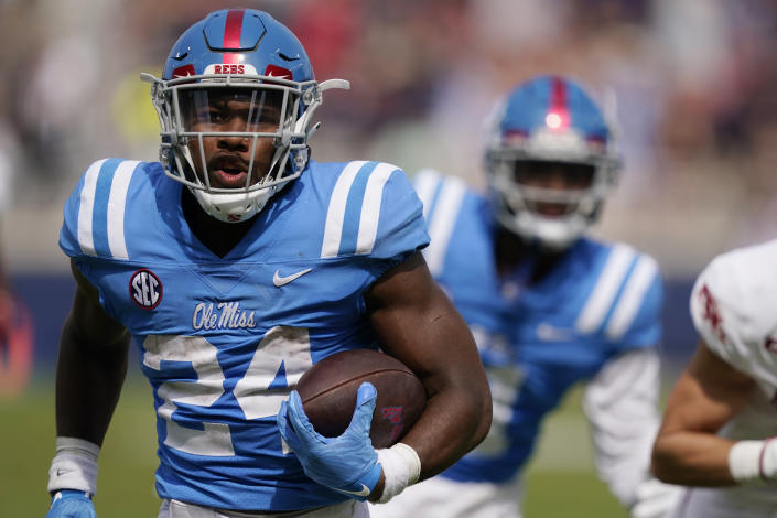 Mississippi running back Snoop Conner (24) rushes past a teammate on his way to a 34-yard touchdown run during the second half of an NCAA college football game, Saturday, Oct. 9, 2021, in Oxford, Miss. Mississippi won 52-51.(AP Photo/Rogelio V. Solis)