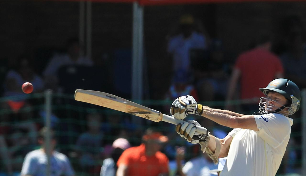 Australia's batsman Chris Rogers, plays a shot on the fourth day of their 2nd cricket test match against South Africa at St George's Park in Port Elizabeth, South Africa, Sunday, Feb. 23, 2014. (AP Photo/ Themba Hadebe)