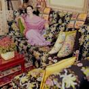 <p>Vanderbilt poses in her home, surrounded by pillows she designed herself.</p>