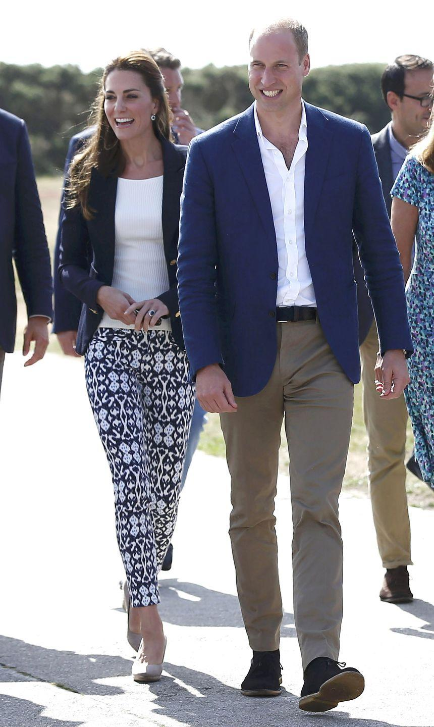 <p>Middleton wears printed skinny ankle pants by Gap, a white top, navy blazer, and nude wedged espadrilles while out in Cornwall with Prince William.</p>