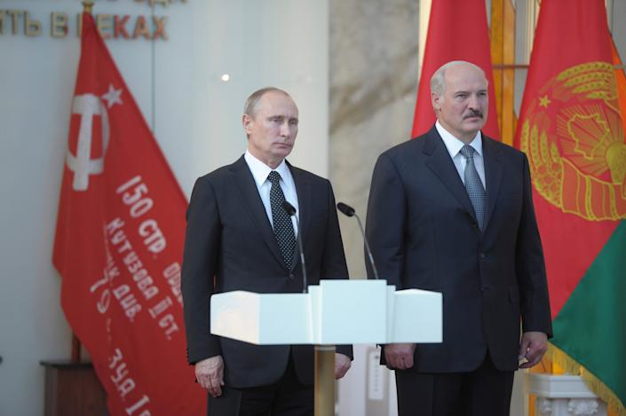 Russia's President Vladimir Putin and Belarus' President Alexander Lukashenko at a ceremony to mark the 70th anniversary of the liberation of Belarus from Nazi occupation, on July 2, 2014.