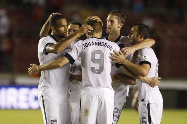 Aron Johannsson (C) of the U.S. celebrates with his team mates after scoring a goal against Panama during their 2014 World Cup qualifying soccer match in Panama City October 15, 2013. REUTERS/Carlos Jasso (PANAMA - Tags: SPORT SOCCER)
