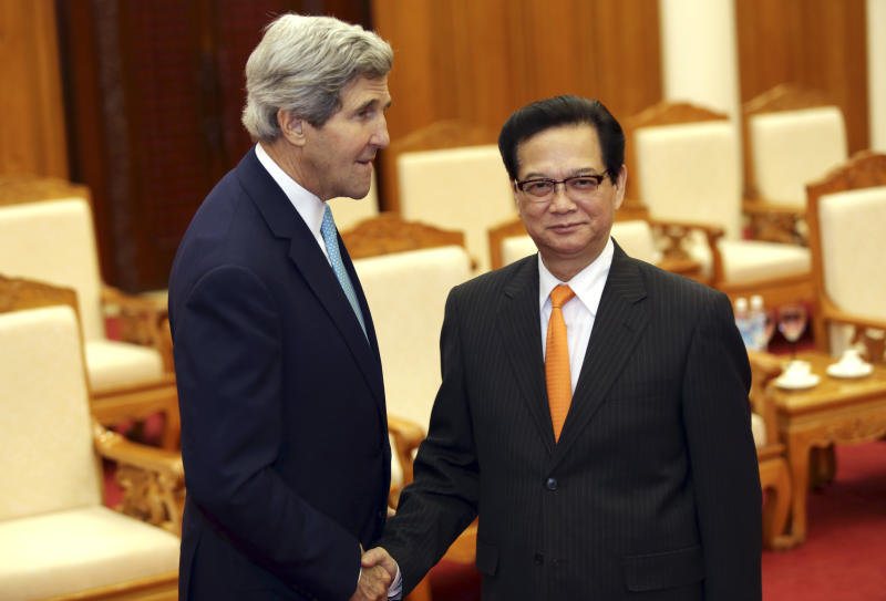 U.S. Secretary of State John Kerry, left, shakes hand with Vietnamese Prime Minister Nguyen Tan Dung in Hanoi, Vietnam Monday, Dec. 16, 2013. The United States will boost maritime security assistance to China's smaller neighbors amid rising tensions over disputed territories in the South China Sea, Kerry announced on Monday during a visit to Vietnam, where he also pressed the communist government on human rights and democratic and economic reforms.(AP Photo/Na Son Nguyen, Pool)