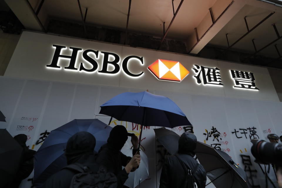 Protestors vandalize a HSBC branch in Hong Kong, Wednesday, Jan. 1, 2020. A huge crowd gathered in Hong Kong Wednesday for an annual New Year's Day protest march as the monthslong pro-democracy movement extends into 2020. (AP Photo/Lee Jin-man)