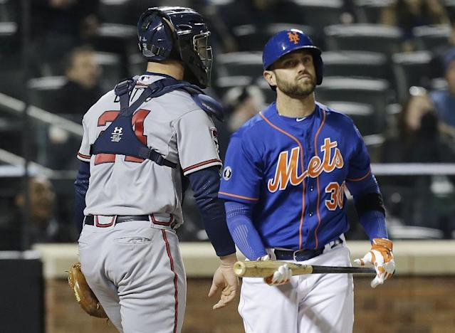 New York Mets' Andrew Brown reacts after striking out during the seventh inning of a baseball game against the Atlanta Braves, Friday, April 18, 2014, in New York. (AP Photo/Frank Franklin II)