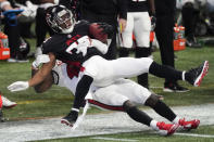 Atlanta Falcons running back Brian Hill (23) is hit by the Tampa Bay Buccaneers during the second half of an NFL football game, Sunday, Dec. 20, 2020, in Atlanta. (AP Photo/John Bazemore)