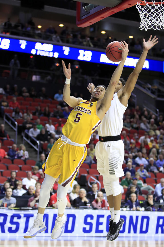 <p>Amir Coffey #5 of the Minnesota Golden Gophers goes up for a shot against the Louisville Cardinals during their game in the First Round of the NCAA Basketball Tournament at Wells Fargo Arena on March 21, 2019 in Des Moines, Iowa. (Photo by Andy Lyons/Getty Images) </p>