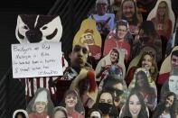A cutout of Bucky, the Wisconsin mascot, holds a sign during the second half of an NCAA college basketball game between Wisconsin and Michigan Sunday, Feb. 14, 2021, in Madison, Wis. (AP Photo/Morry Gash)
