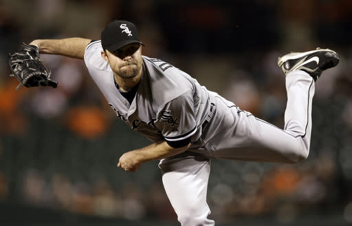 Chicago White Sox starting pitcher John Danks follows through to the Baltimore Orioles in the third inning of a baseball game on Friday, Sept. 6, 2013, in Baltimore. (AP Photo/Patrick Semansky)