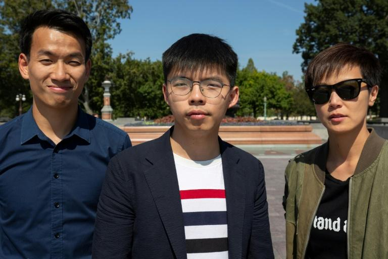 Hong Kong pro-democracy activist Joshua Wong (C); pop singer, actress and LGBT activist Denise Ho (R) and University of Washington student Brian Leung Kai-ping pose for a photo near the US Capitol in Washington, DC, on September 21, 2019 (AFP Photo/Alastair Pike)